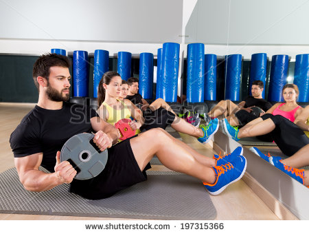 stock-photo-abdominal-plate-training-core-group-at-gym-fitness-workout-197315366